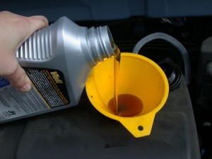 Motor_oil_refill_with_funnel